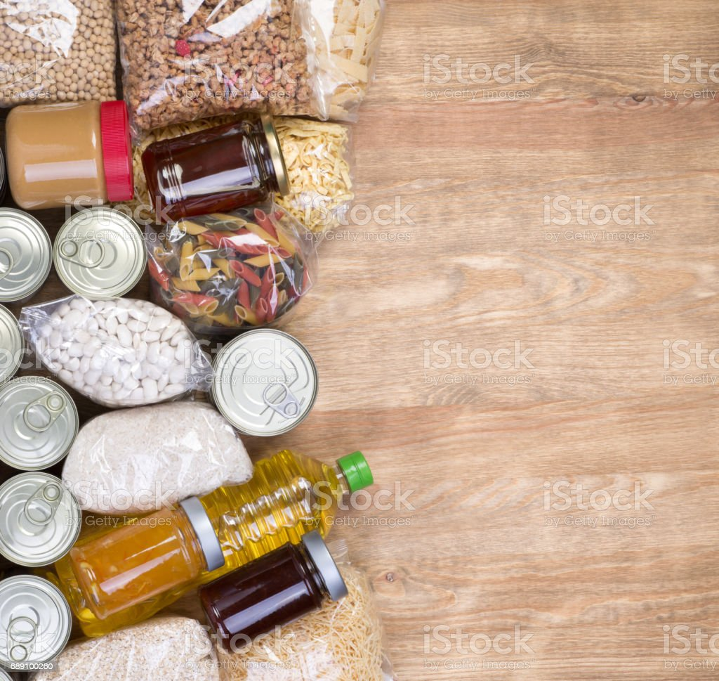 Food donations on wooden background stock photo