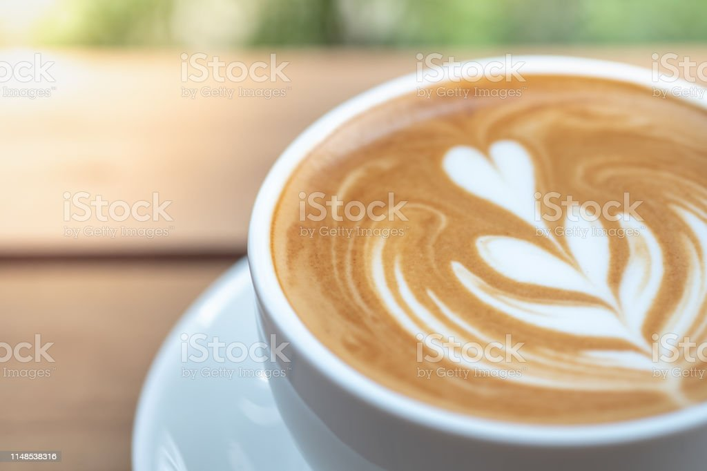 Food, Drink and Relaxation concept. Close up of white cup of hot...