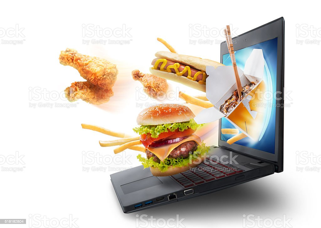 Food flying out of a laptop screen stock photo