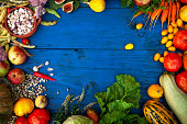 Food Frame of Assorted Fresh Organic Produce on Blue Rustic Table
