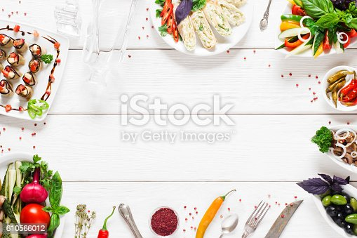 istock Food frame on white wooden table, free space 610566012