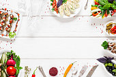 Food frame on white wooden table, free space