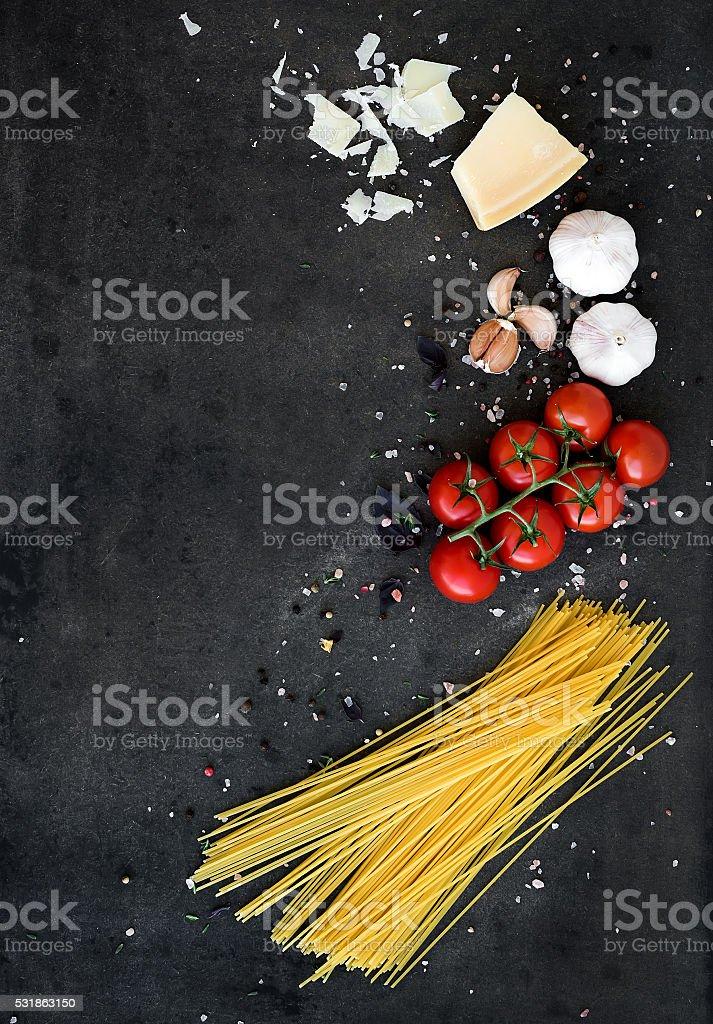 Food frame. Pasta ingredients. Cherry-tomatoes, spaghetti pasta, garlic, basil stock photo
