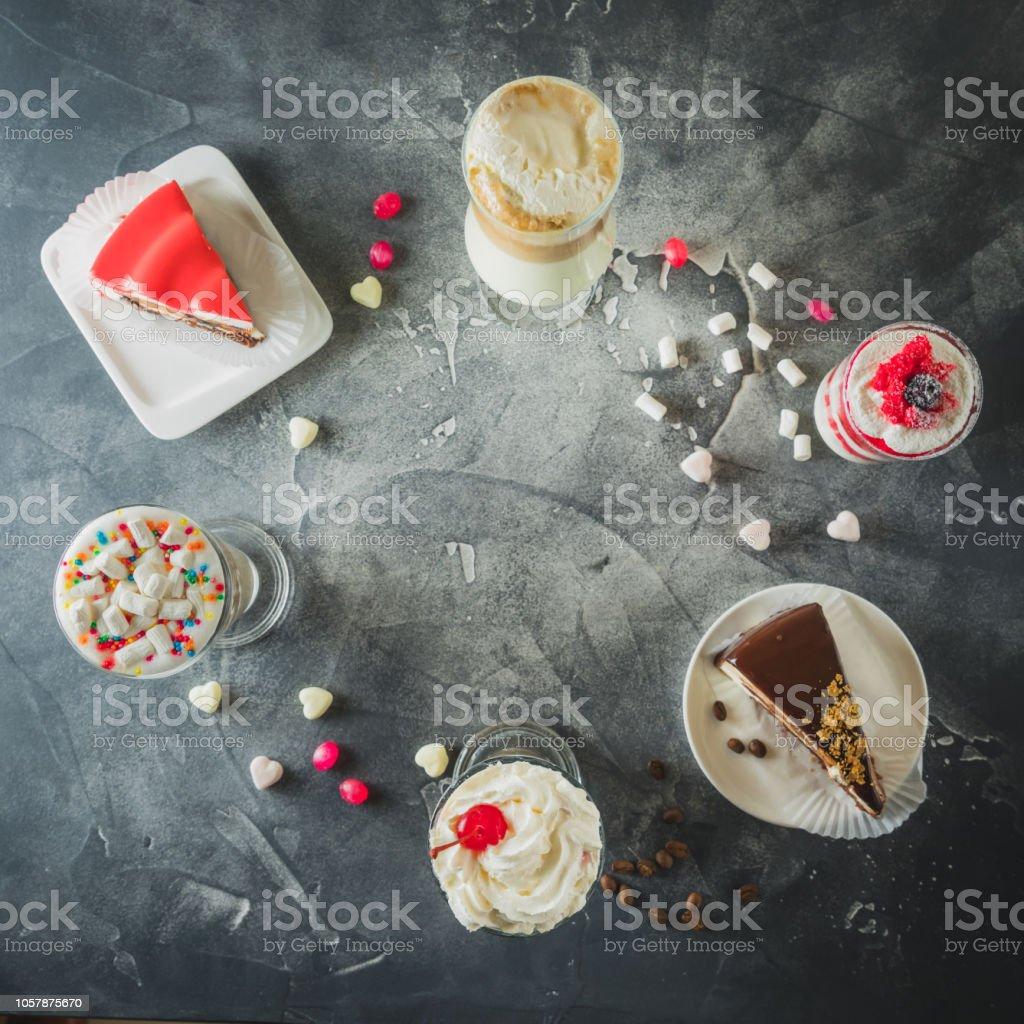 Food frame with milkshake drinks and desserts. Milkshakes and cake