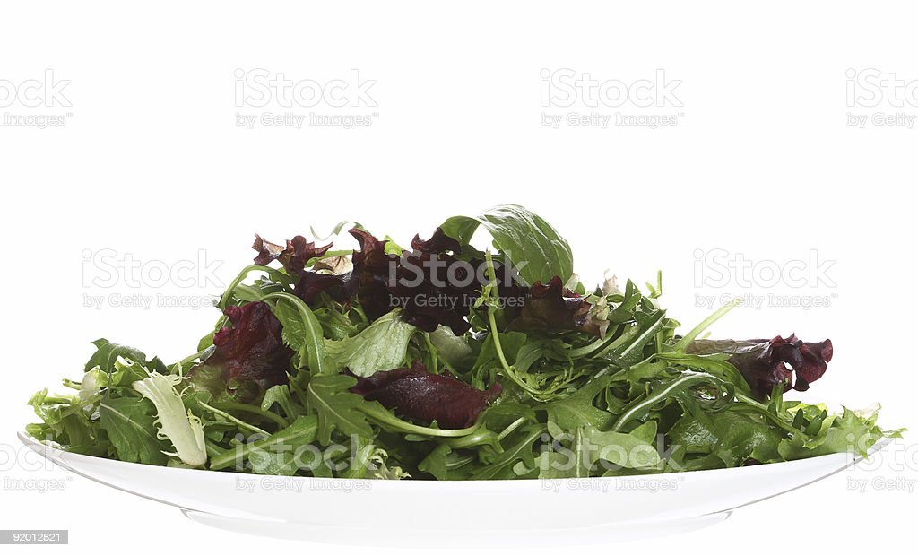 food - fresh green leaf salad on white plate isolated stock photo