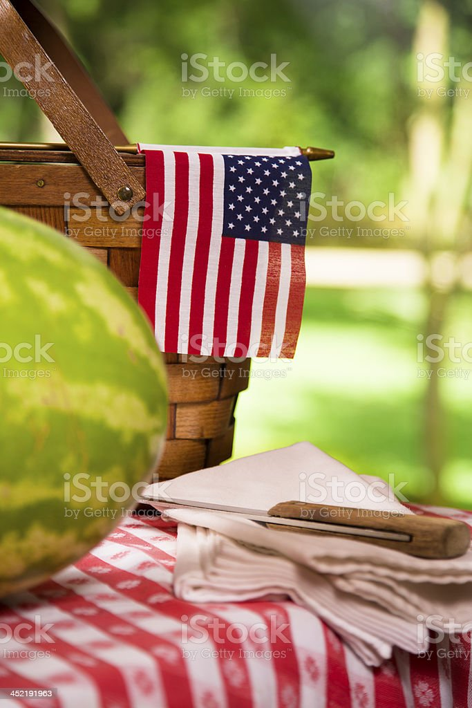Food:  Fresh red ripe watermelon on traditional checked picnic tablecloth. royalty-free stock photo