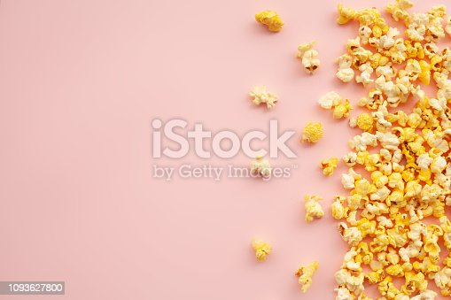istock Food. Frozen Popcorn Corn Delicious Yellow Popcorn on Pink Background. Cinema. Copyspace. Place for Text. 1093627800