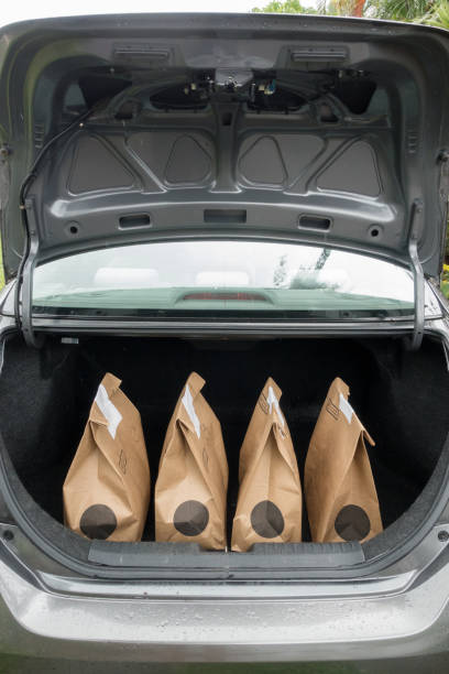 Food Groceries in Trunk of Car COVID-19 Food Groceries in Trunk of Car using curbside pickup service for social distancing. curbsidepickup stock pictures, royalty-free photos & images
