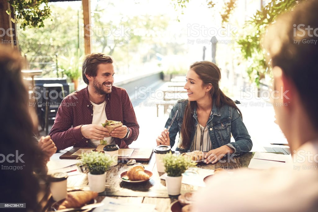 Food has a way of making the conversation better stock photo