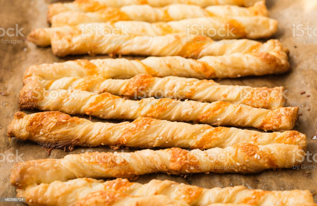 Food. Homemade baking. Bread products. Cheese bread sticks. Cheesy Breadsticks. stock photo