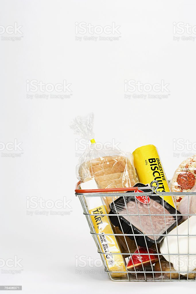 Food in a shopping basket foto de stock royalty-free