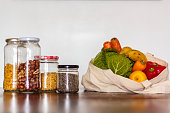 istock Food in glass jars and reusable bag with groceries. Zero Waste, plastic free concept 1126806231