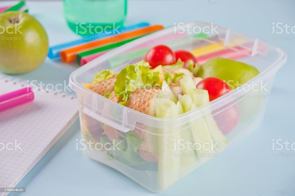 Food in the office or at school. Lunch box with healthy food on the...