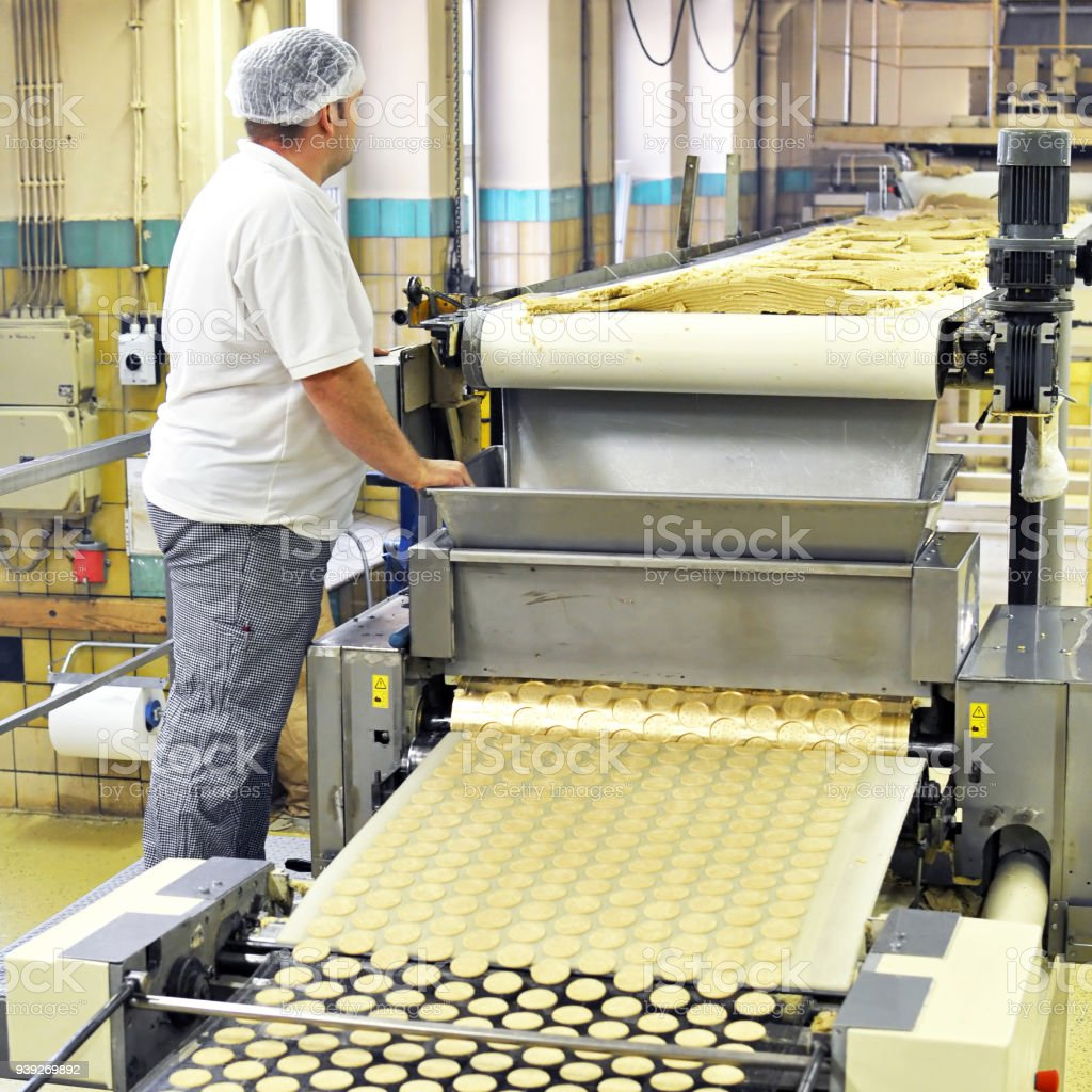 food industry - biscuit production in a factory on a conveyor belt stock photo