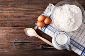 istock Food ingredients and kitchen utensils for cooking on wooden background 640293980