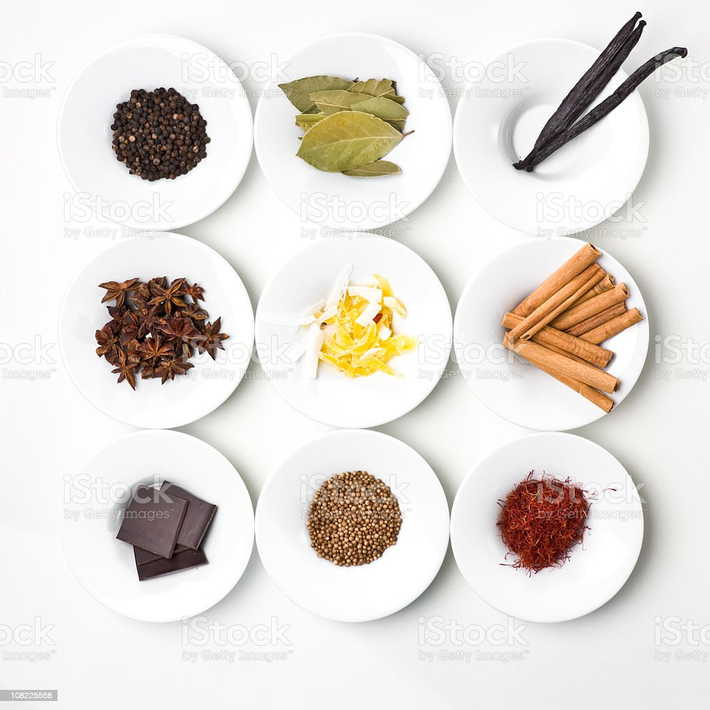 Food Ingredients and Spices Organized on White Plates stock photo
