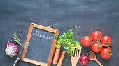 Food ingredients,vegetables, kitchen utensils and blackboard for menu, free copy space, flat lay