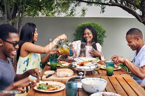 istock Food is best shared with friends and family 1064987554