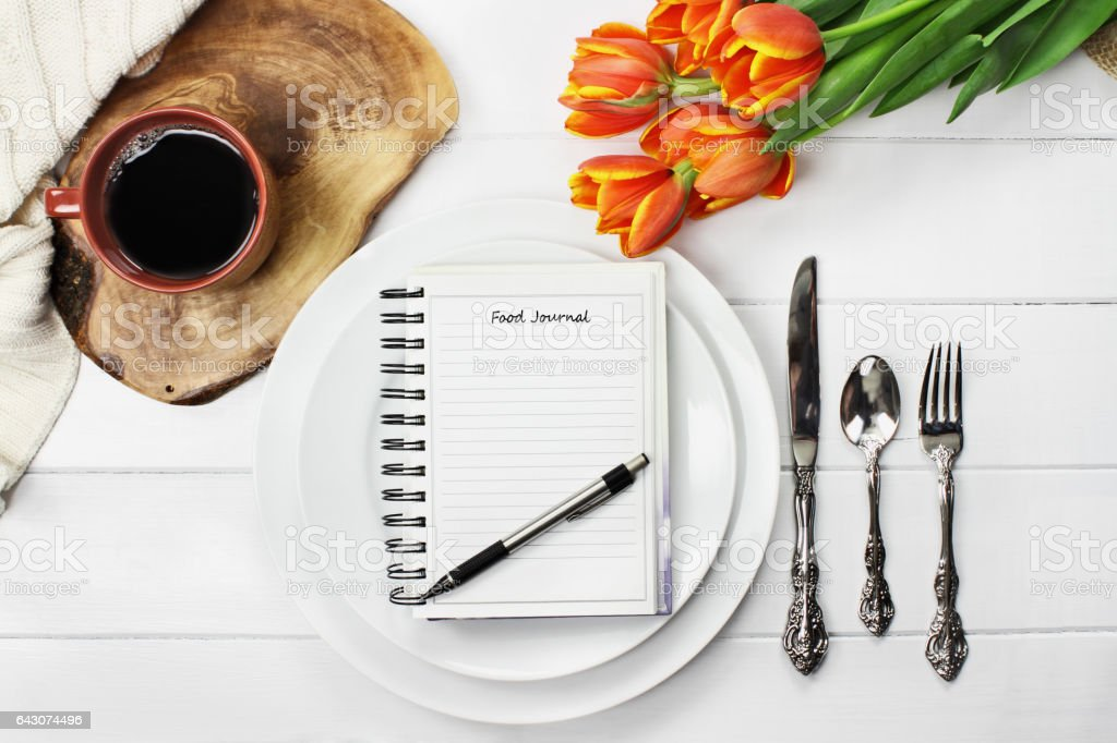 Food Journal and Place Setting stock photo