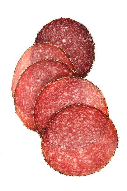 food meat - german pepper salami sausage sliced stock photo