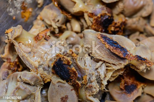 istock Food mishaps. Chicken stomachs burned out badly during cooking. Overcooked, accidentally burnt or just plain ugly food. 1194262293