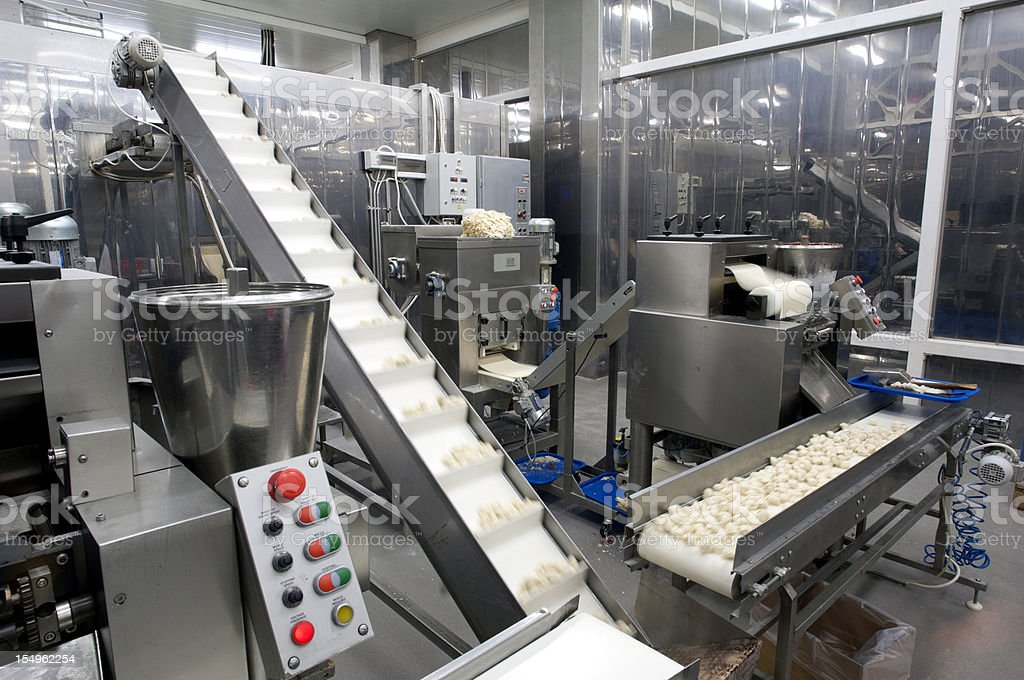 Food moving through production line in factory stock photo