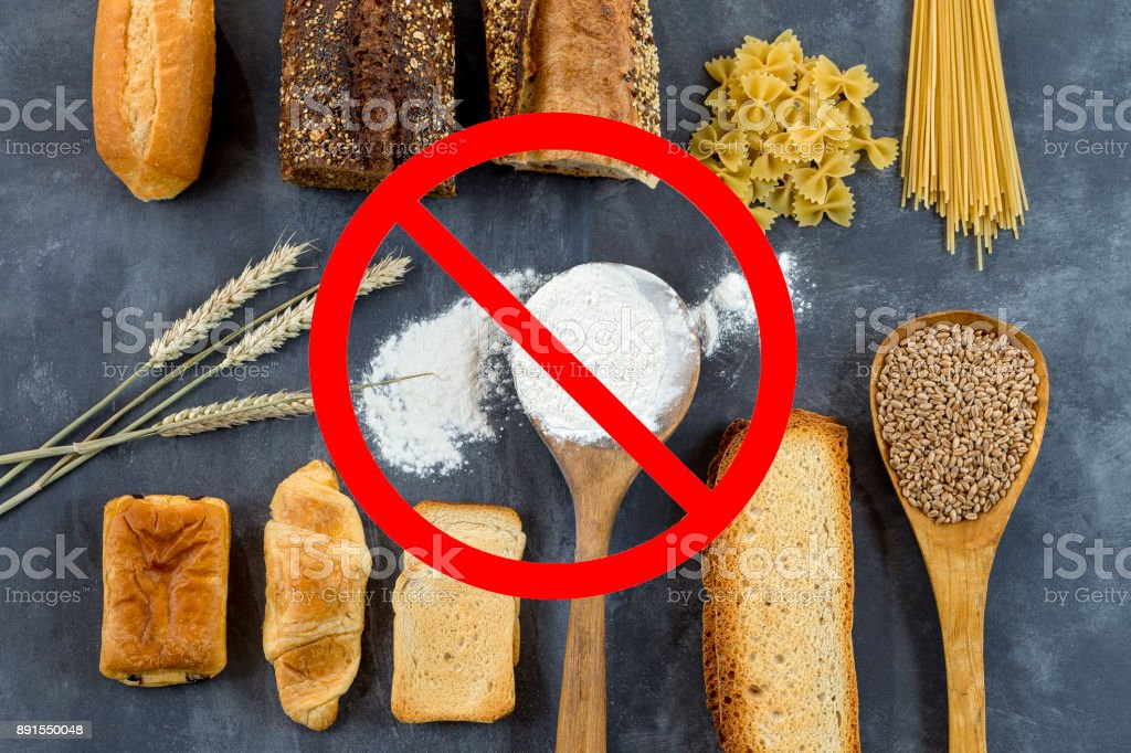 food non gluten free, with cerales grains with interdiction symbols on grey stock photo