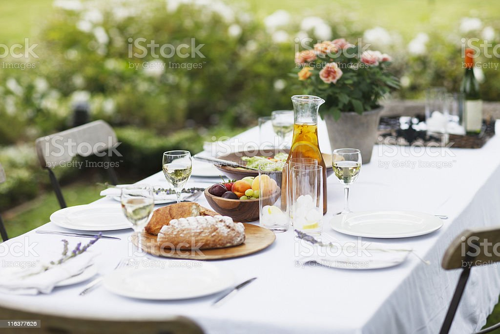 Food on table in garden stock photo