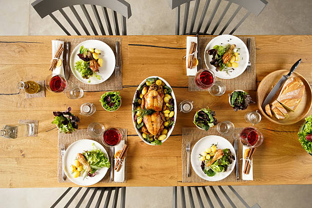 food on table - dining table stock photos and pictures