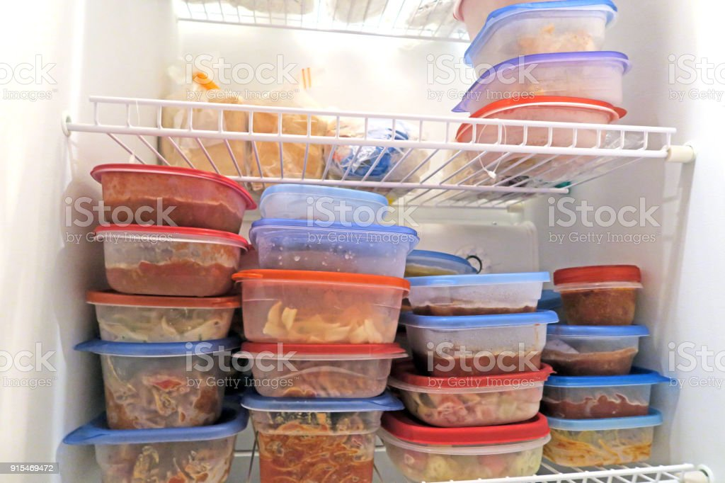 Food packaged and frozen inside a home freezer stock photo