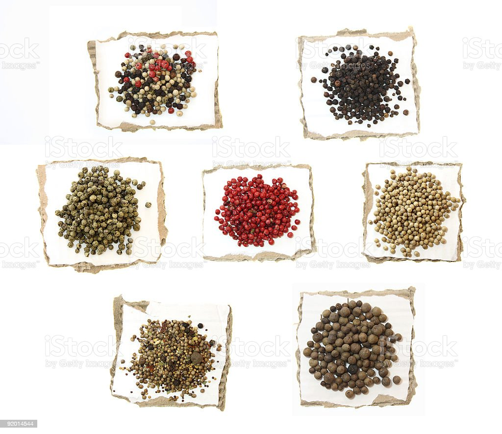 food - Peppercorns Peppers hot Spices on pieces of paper stock photo