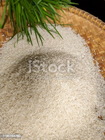 photo of white grain rice inside flat bamboo basket with onion chives background stock photo