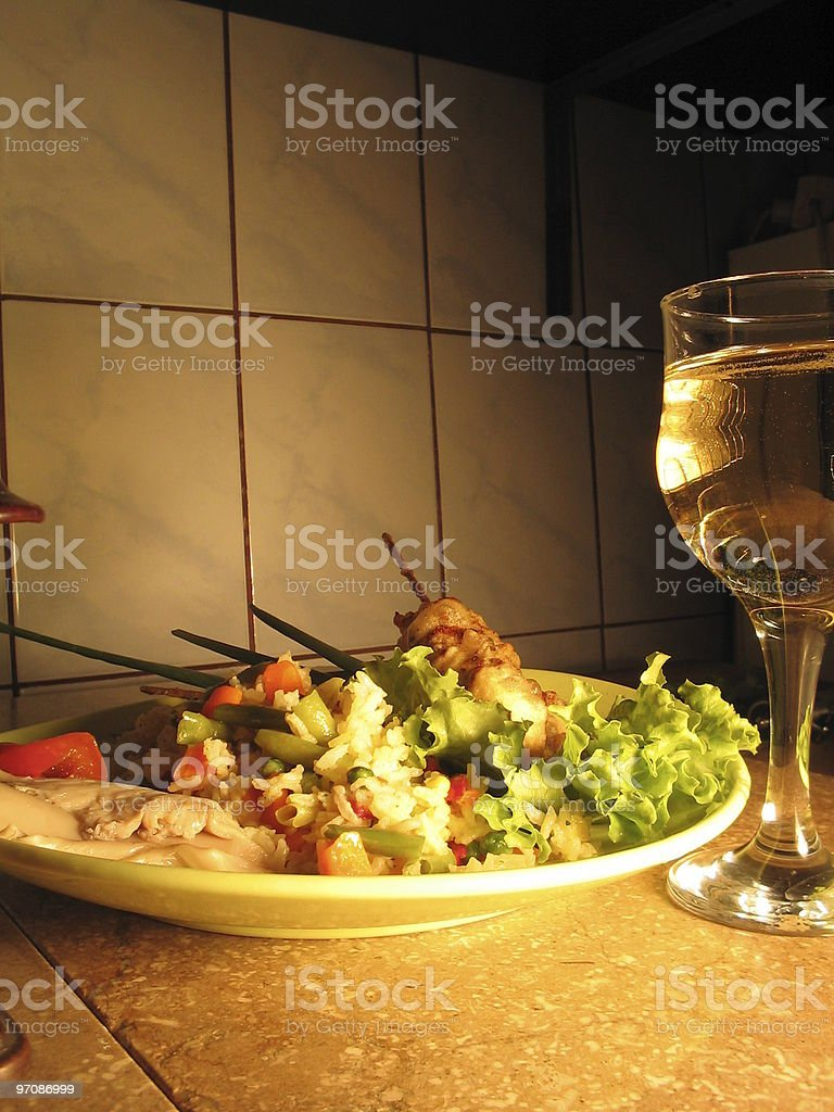 Food Plate with vine glass in foreground. royalty-free stock photo