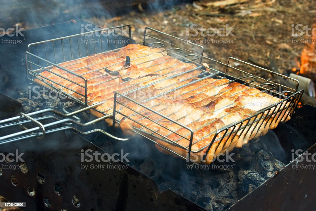Food preparation: barbecue or grill of fish (tout) prepared with brazier and coat for a weekend picnic. stock photo