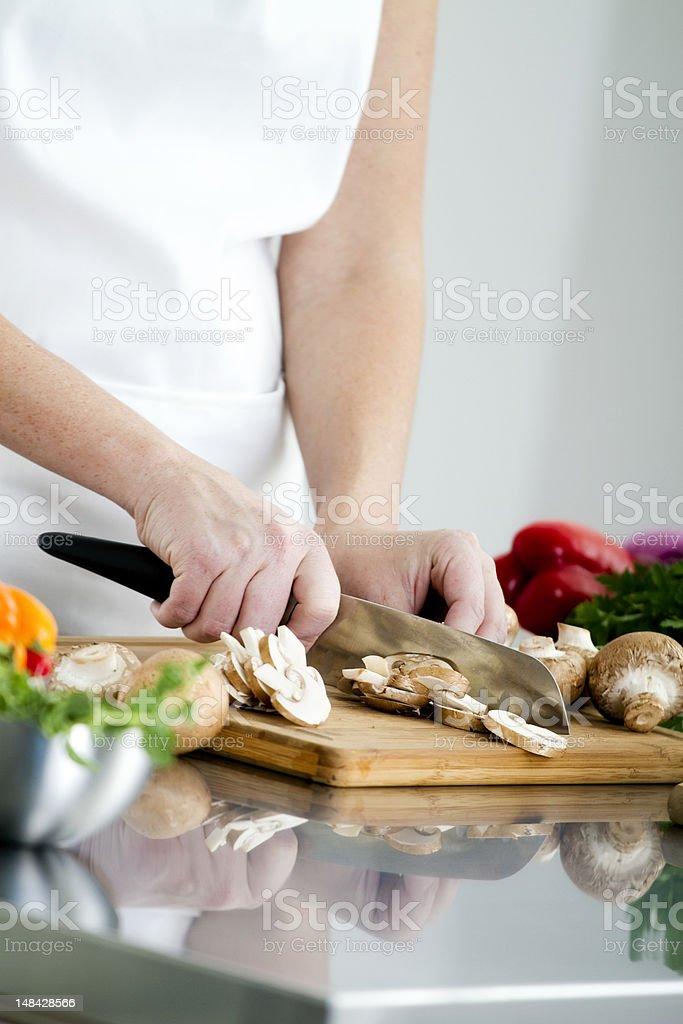 Food Preparation - Cutting a Mushroom royalty-free stock photo