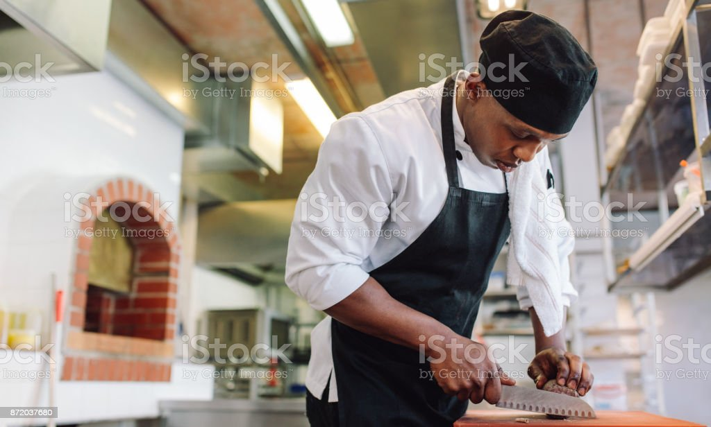 Food preparation in commercial kitchen stock photo