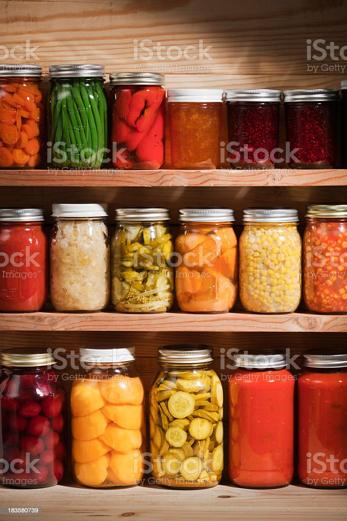 Food Preserves Canning Jars on Shelves, Fruit and Vegetable Storage stock photo