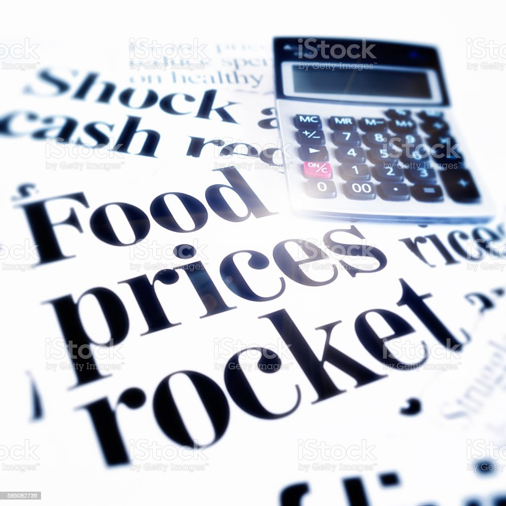 'Food prices rocket' say newspaper headlines with calculator stock photo