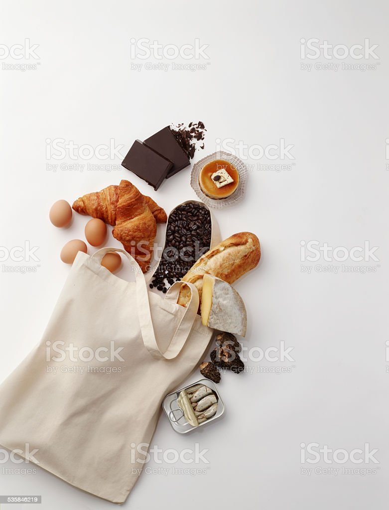 Food Re-useable canvas bag with French market ingredients stock photo