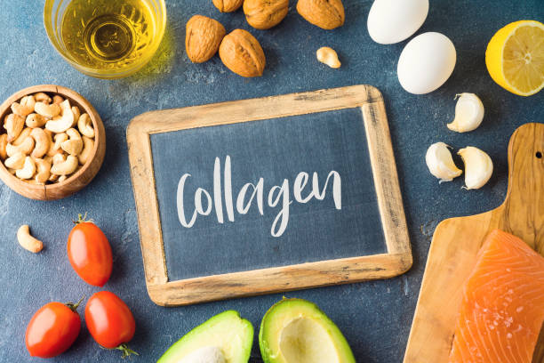 Food rich in collagen concept. Healthy eating and dieting with salmon fish, avocado, eggs and nuts. stock photo