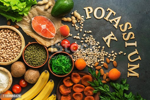 istock Food rich in potassium, salmon, legumes, vegetables, fruits, nuts on a dark background. Healthy food concept, avitaminosis prevention. Top view, flat lay. 1153886426