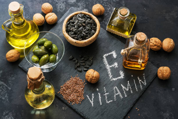 Food rich in vitamin E. A set of different oils. Seeds of flax, sunflower, walnut, olives. Top view. Food rich in vitamin E. A set of different oils. Seeds of flax, sunflower, walnut, olives. Top view letter e stock pictures, royalty-free photos & images