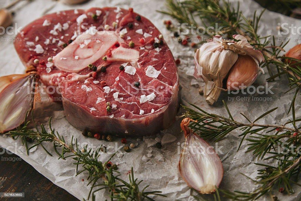 Food set, spices, raw steak, onions closeup stock photo
