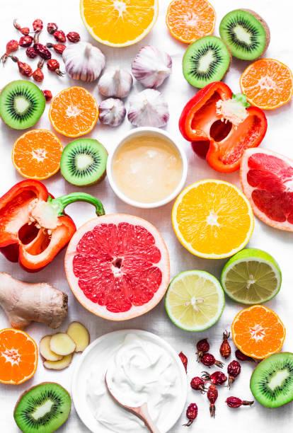 lebensmittel set winter boost immunität. gesunder lifestyle-konzept, vorbeugung von erkältungen. flach legen, top aussicht - immunsystem stärken stock-fotos und bilder