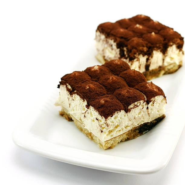 Food shot of two tiramisu cakes on a plate stock photo
