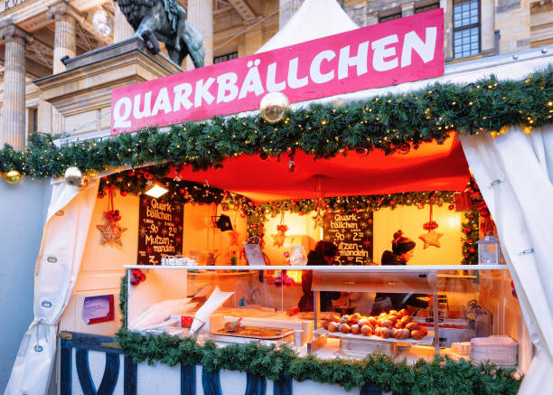 Food stall at Christmas Market at Gendarmenmarkt Winter Berlin Germany Berlin, Germany - December 8, 2017: Food stall at Christmas Market at Gendarmenmarkt in Winter Berlin, Germany. Advent Fair Decoration and Stalls with Crafts Items on the Bazaar. gendarmenmarkt stock pictures, royalty-free photos & images