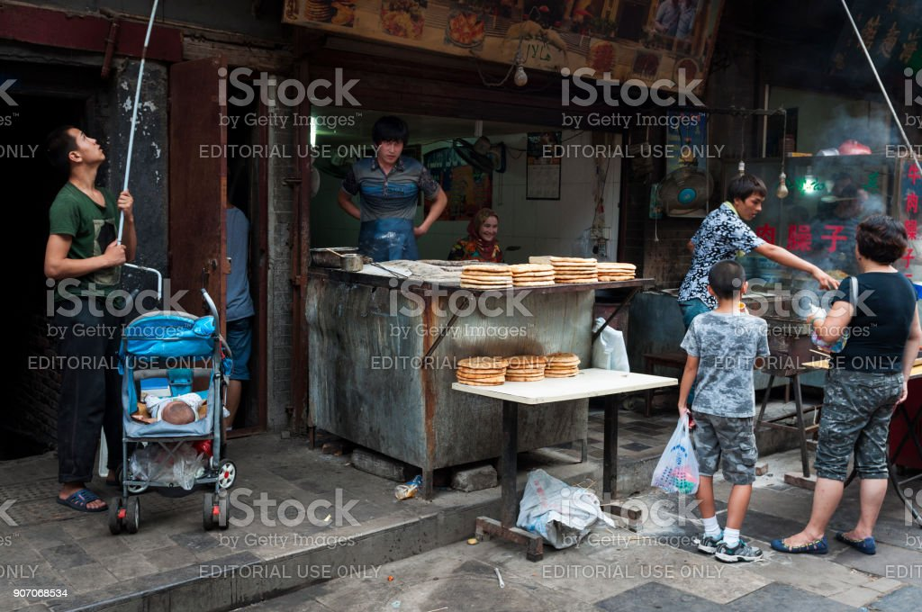 Food stall in a street of the Muslim Quarter in the city of Xian in China stock photo