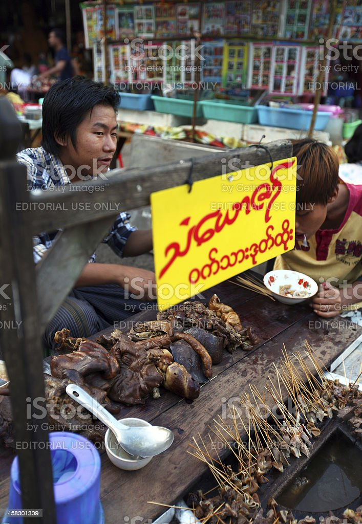 Food stall with beef and pig giblets, entrails in Myanmar royalty-free stock photo