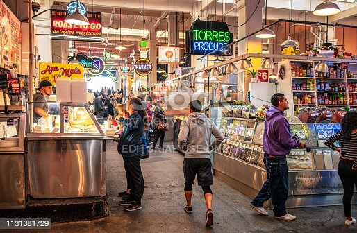 Los Angeles, USA - People in Grand Central Market in downtown Los Angeles, with a wide diversity of food stalls to choose from.