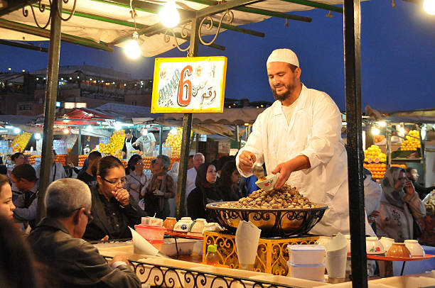 Food stand in the square of Marrakech - foto de stock
